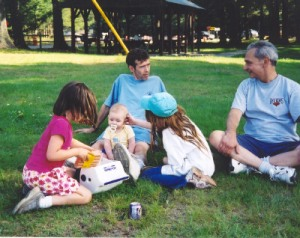 Hanging out with the Great Burt Shaw at the 2004 Reunion, with a little five-month old Dude on my lap and a very small Emily Rudden and another little girl gushing over him. Burt found out I wasn't going to the bonfire that night and said,